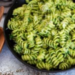 Close up of rotini pasta with avocado pesto sauce.