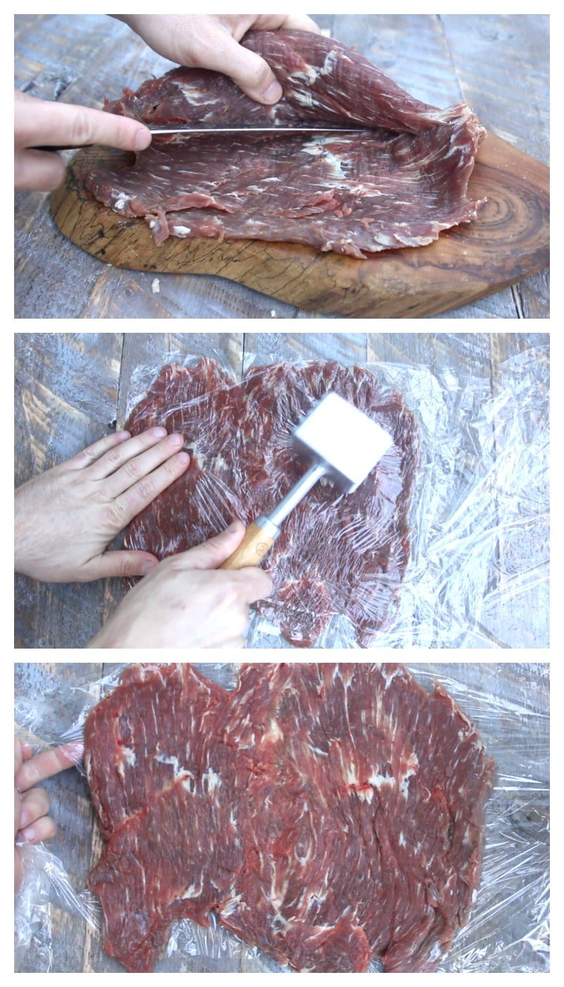 butterflied flank steak being flattened with a meat tenderizer