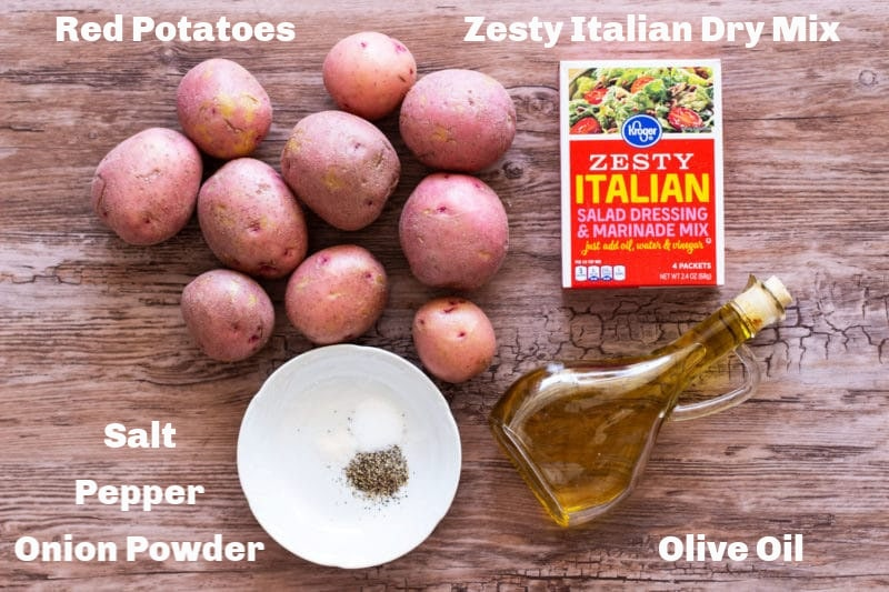 Red potatoes, zesty Italian Mix, olive oil and seasonings on counter.