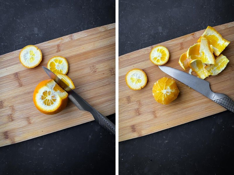 Slicing oranges on a cutting board.