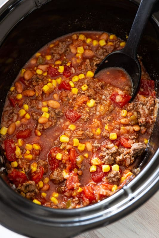 Southwestern Crockpot Beef Stew being served with a spoon