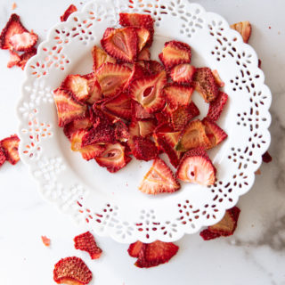 White plate containing dried strawberries