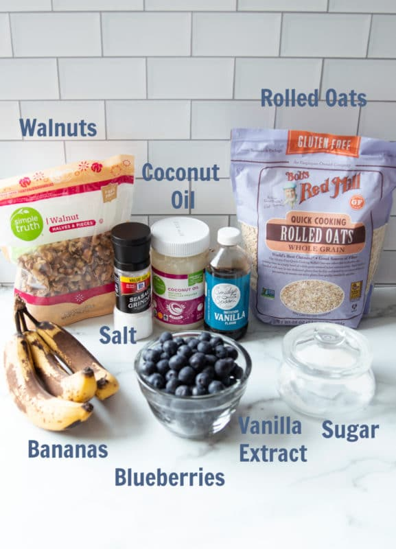 Ingredients on a marble countertop for making oatmeal muffins.