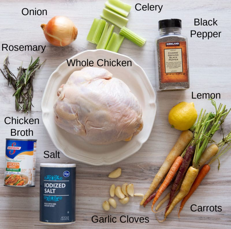 Whole Chicken, onion, vegetables, seasoning, and broth on a counter.
