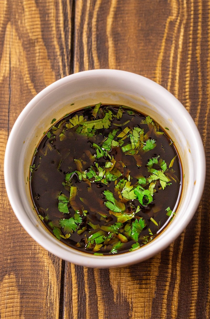 Stir fry sauce in a bowl topped with fresh chopped cilantro.