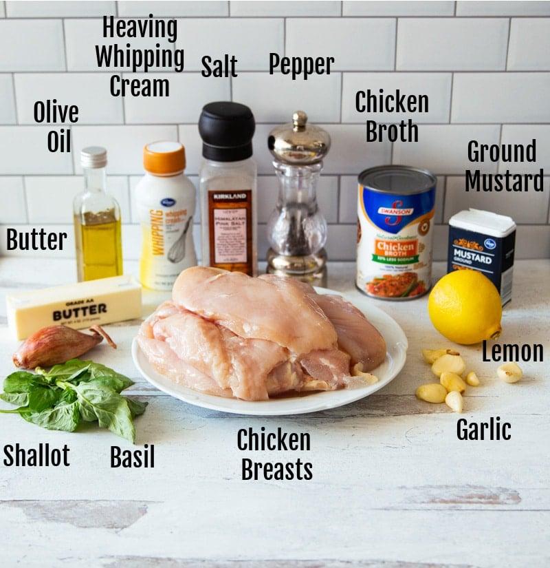 Breasts, shallot, basil, garlic, lemon, broth, salt, pepper, whipping cream on counter.