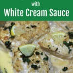 Chicken breasts cooked in a dutch oven topped with cream sauce.