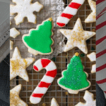 Decorated Christmas cookies on a wire rack.