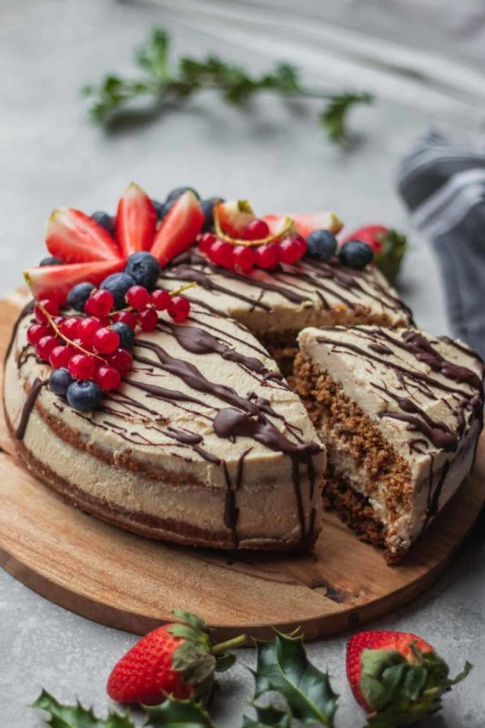 Gingerbread cake topped with fresh fruit and chocolate fudge.