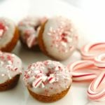 Mini glazed donuts topped with crumbled peppermint.