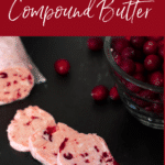 Three slices of cranberry butter on a black dish, cranberries on the side.