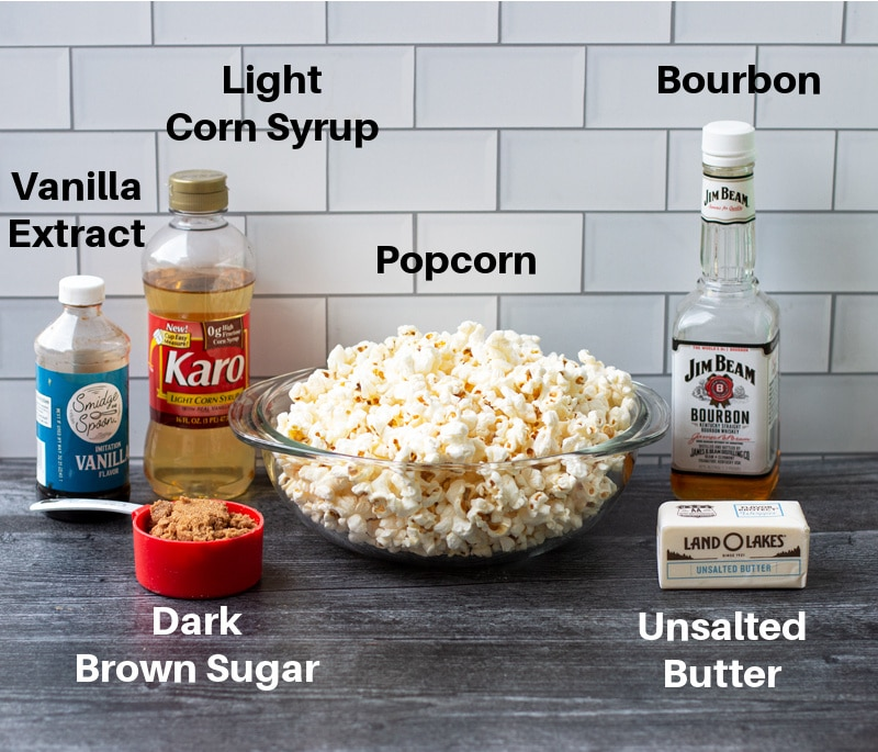 Ingredients on a counter for making caramel popcorn, including bourbon.