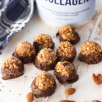 Peanut butter protein balls dipped in chocolate on a table, Naked Collagen protein powder in background.