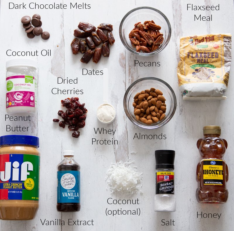 Wet and dry ingredients needed to make energy balls sitting on a counter.