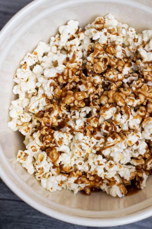 Bowl filled with caramel popcorn.
