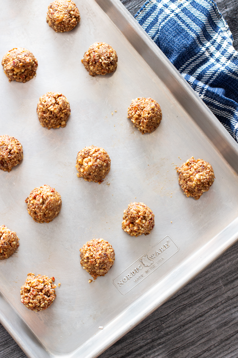 Cookie sheet filled with bite-size protein bites.