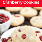 Plate of shortbread cookies topped with cranberries.