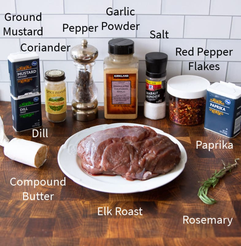 Elk, butter, paprika, red pepper flakes, salt, pepper, garlic powder, and other spices on a counter.
