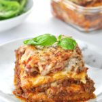 White plate containing lasagna.