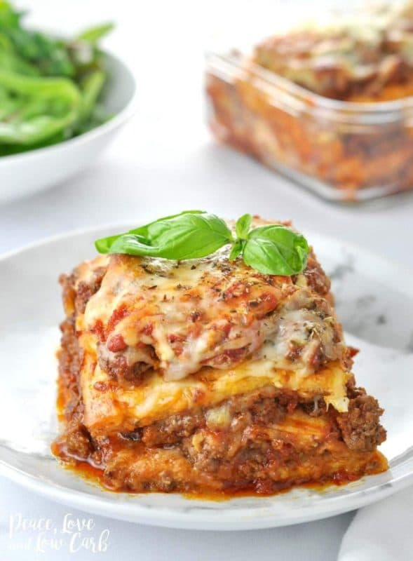 A slice of keto lasagna on a white plate.