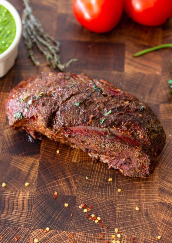 Elk roast recipe resting on a cutting board.