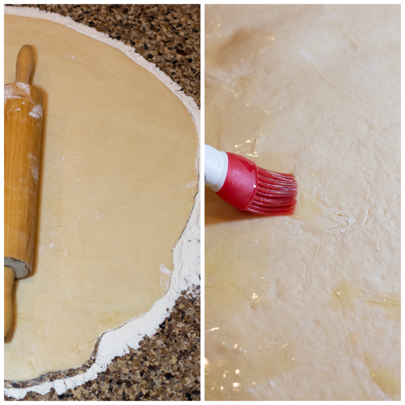 Rolling pin being used to roll out dough, butter being basted in tge dough.