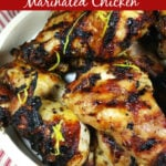 Grilled Greek Marinated Chicken in a bow topped with lemon zest.