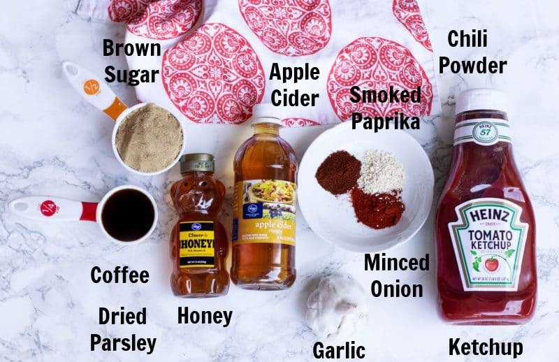 Ketchup, apple cider vinegar, honey, brown sugar, coffee and spices on counter.