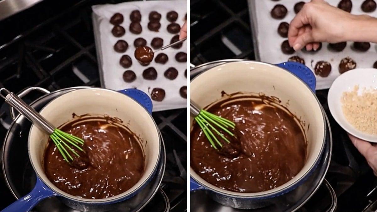 Person sprinkling almonds onto truffle balls.