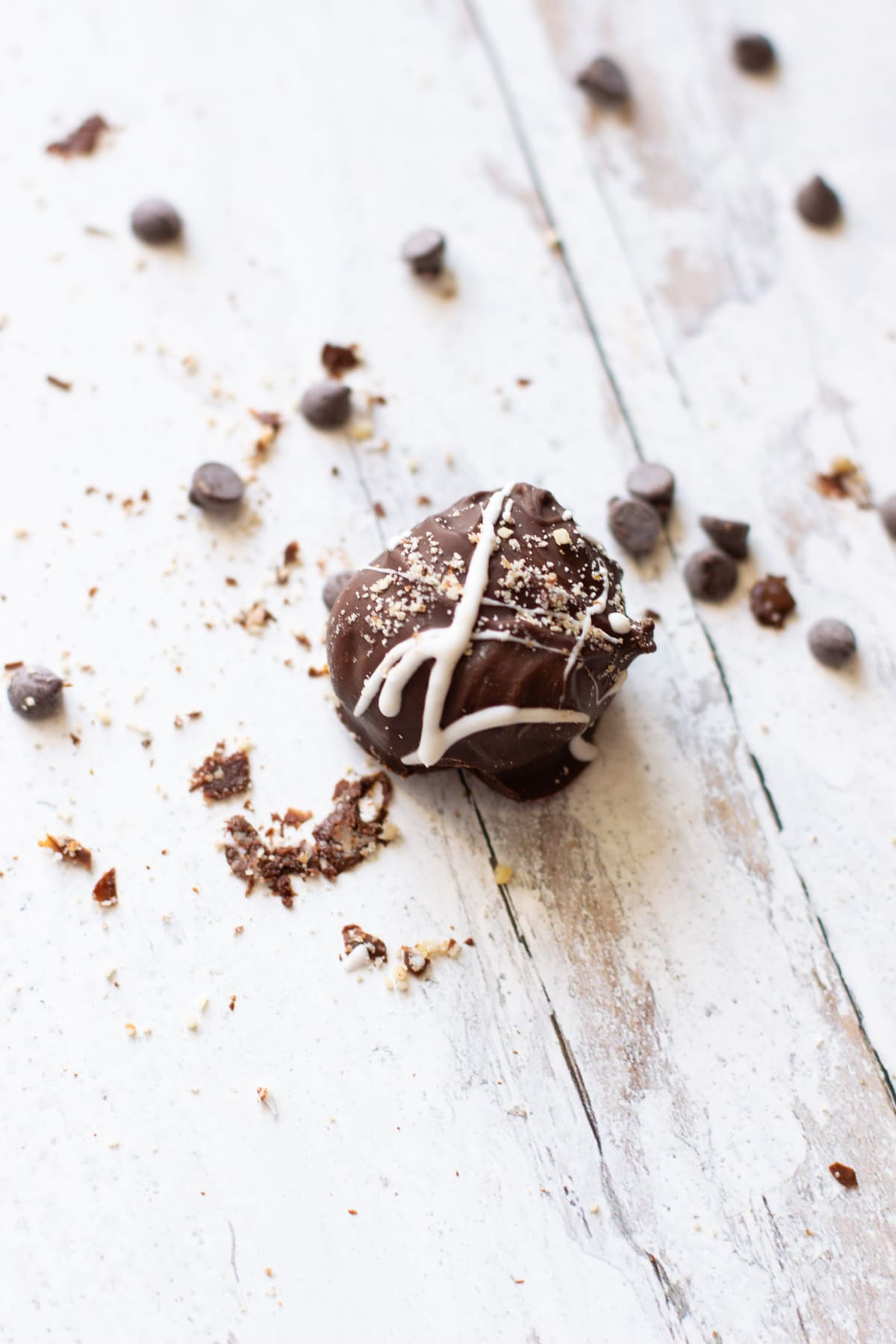 An amaretto truffle ball on a counter.