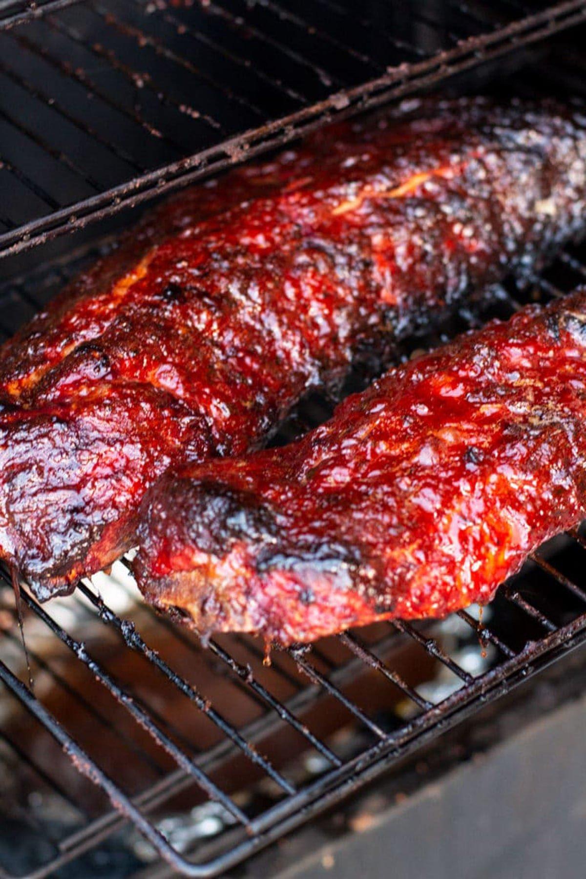 2 slabs of BBQ ribs on a smoker.