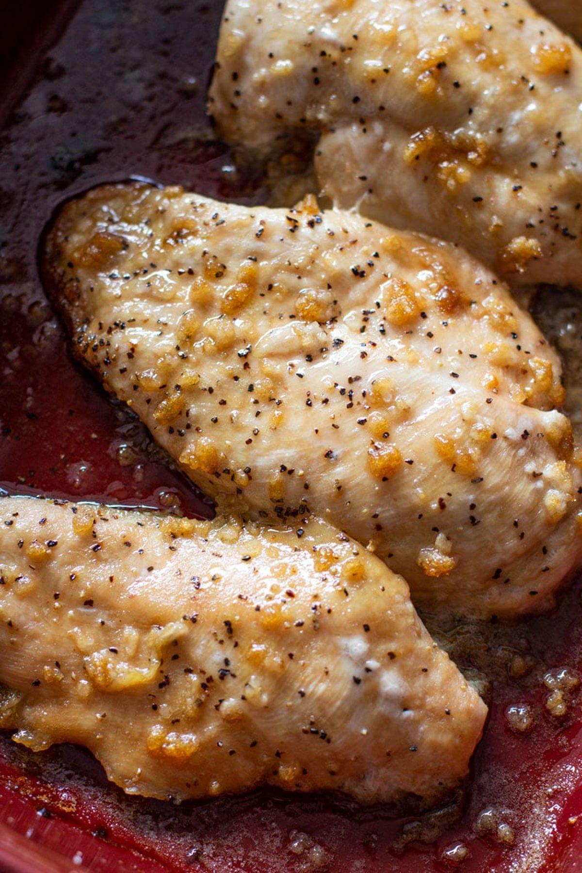 Baked Brown Sugar Garlic Chicken in an oven dish.