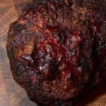 Whole smoked chuck roast sitting on cutting board.