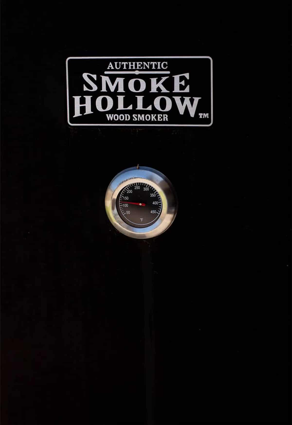 Picture of the door of a black Smoked Hollow Wood Smoker.