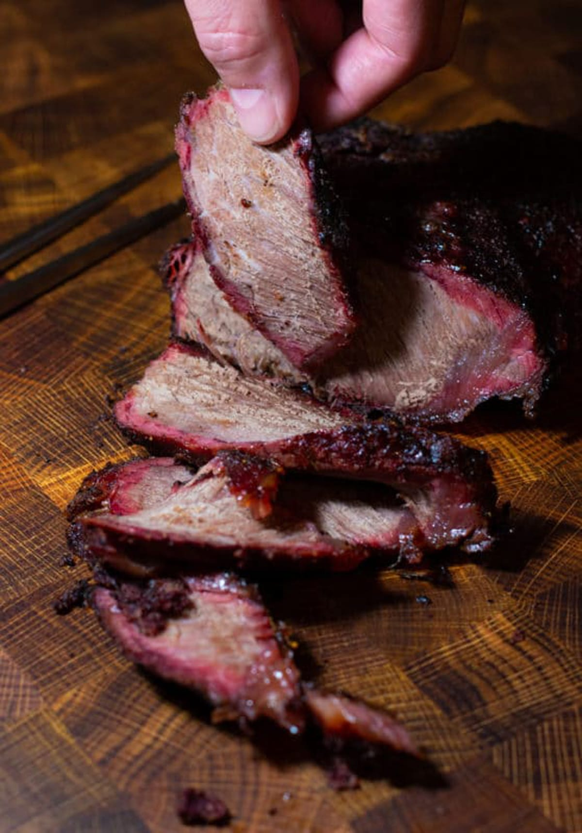 Person holding sliced chuck roast.