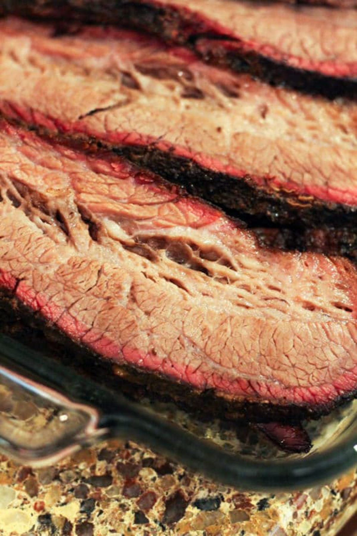 Close up of slices of brisket with the smoker ring.
