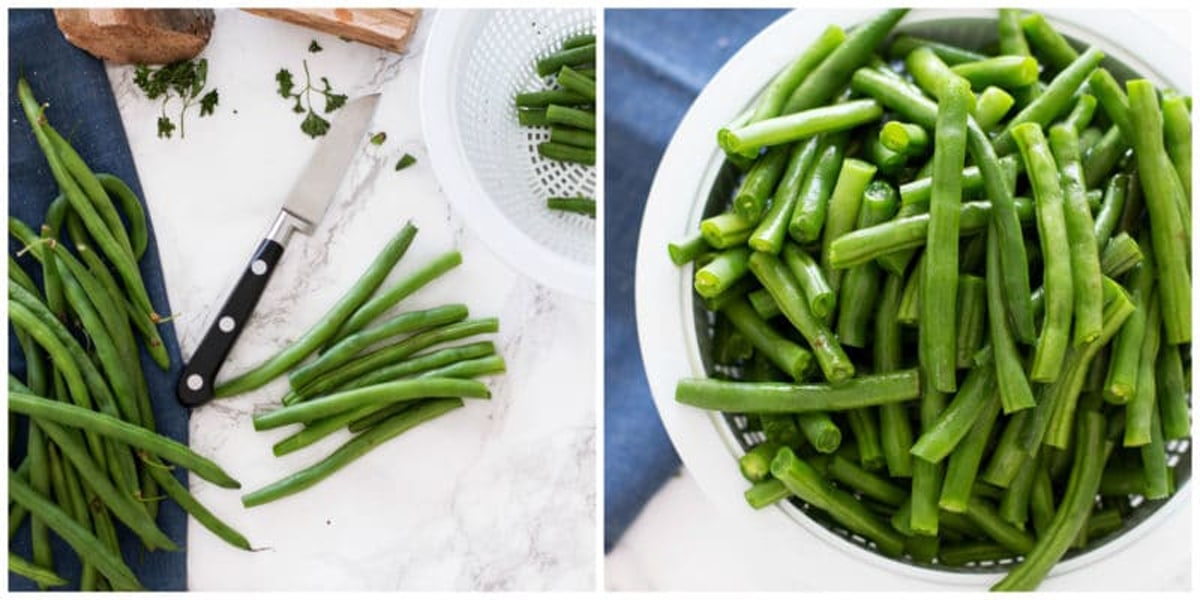 Knife and trimmed and halved string beans in a colander.