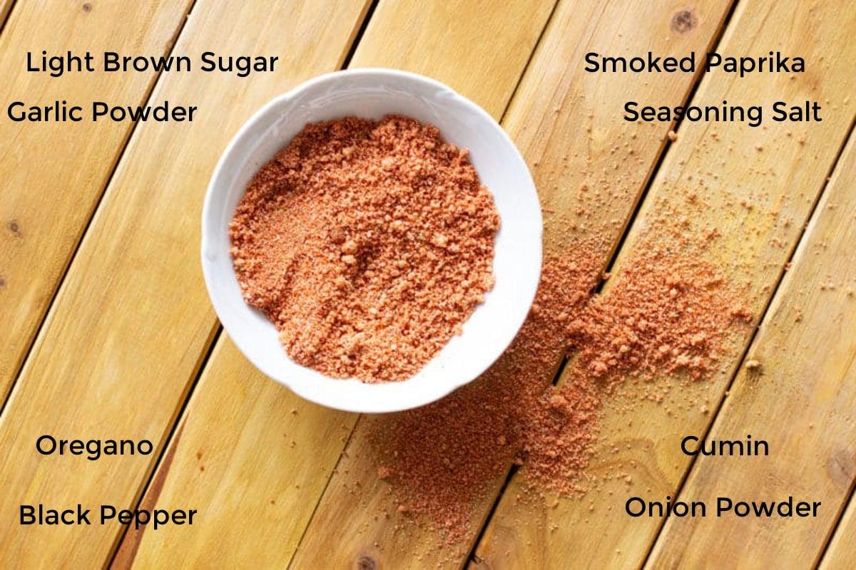 White bowl containing seasonings for a brisket rub.
