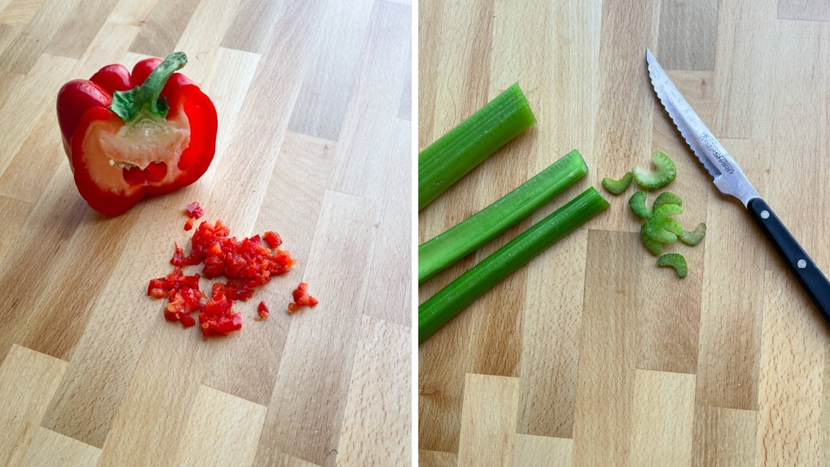 Chopped red pepper and celery on a cutting board.