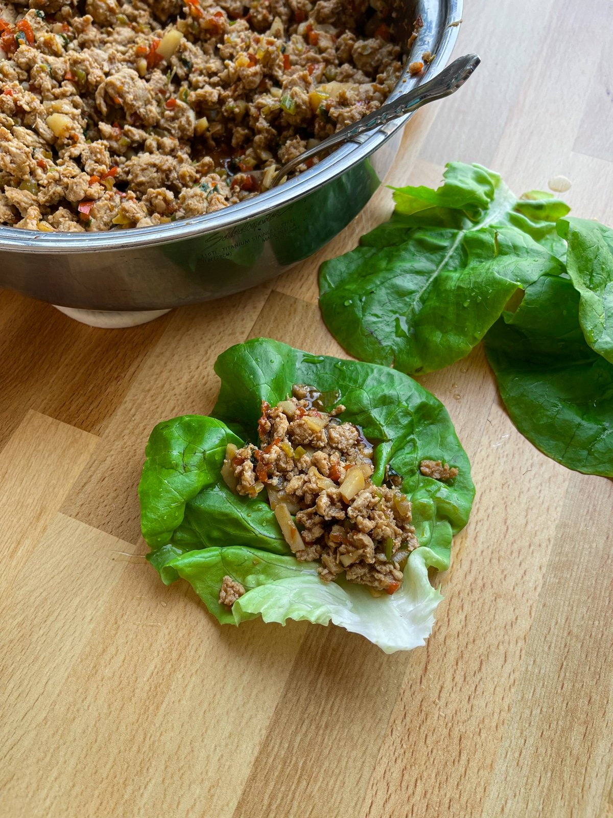 Asian lettuce wraps being served.