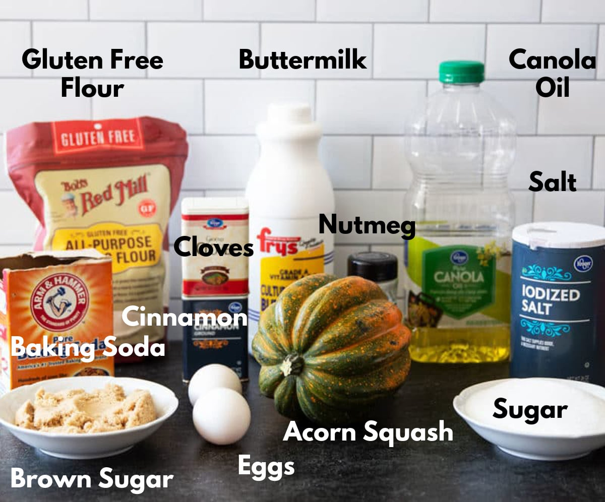 acorn squash, eggs, sugars, flours, and spices on a counter.