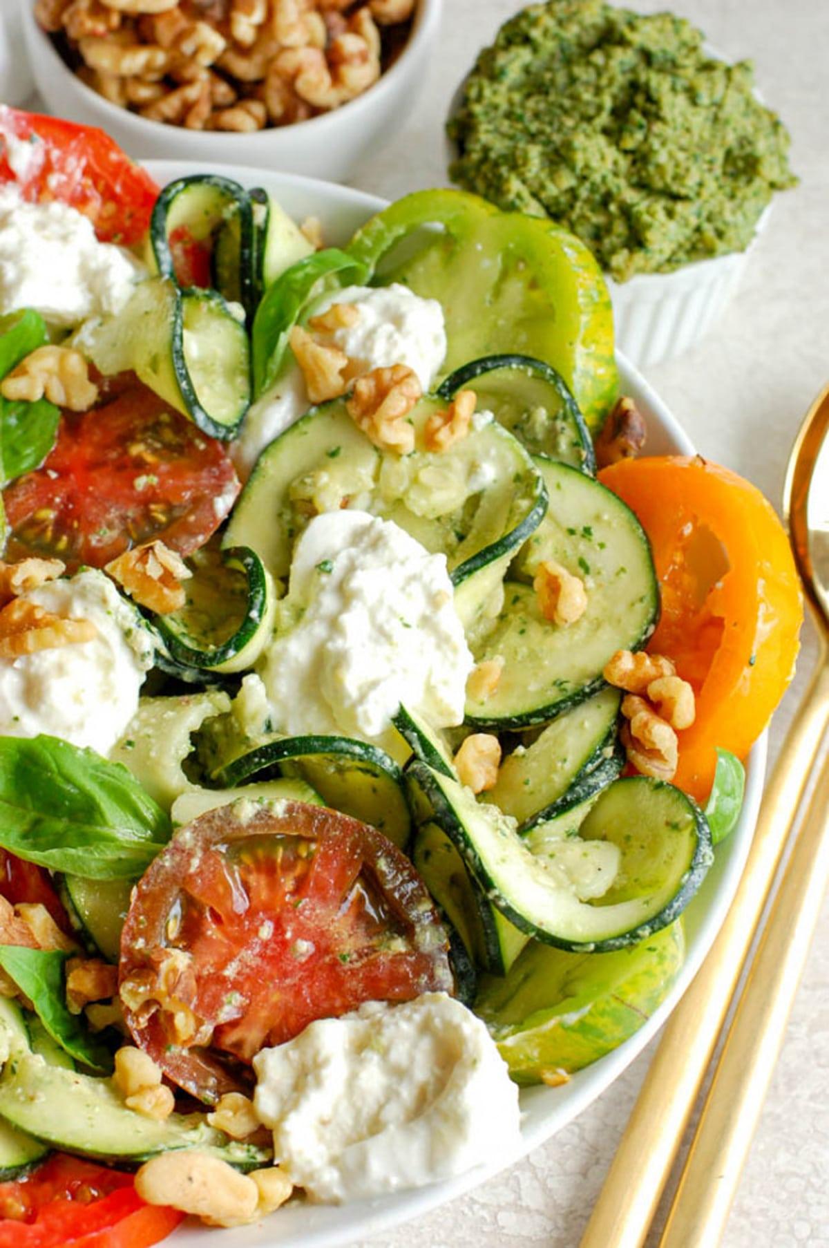 Caprese Salad covered in a pesto sauce.