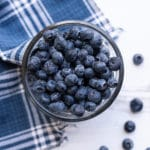 Glass bowl filled with fresh blueberries.