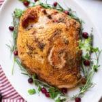 Smoked bone in turkey breast on a platter.