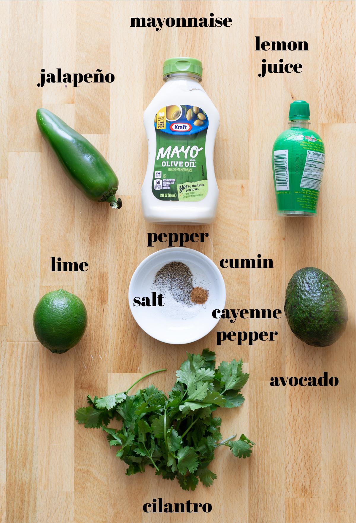 mayonnaise, avocado, lemon and lime juice and seasonings on table.